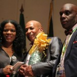 DUKA president Vincent John (r) and Valley Fontaine (l) present prize. Photo courtesy CaribDirect.com