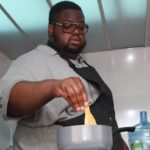 Chef Solomon Smith demonstrating how to prepare curry goat. Photo courtesy CaribDirect